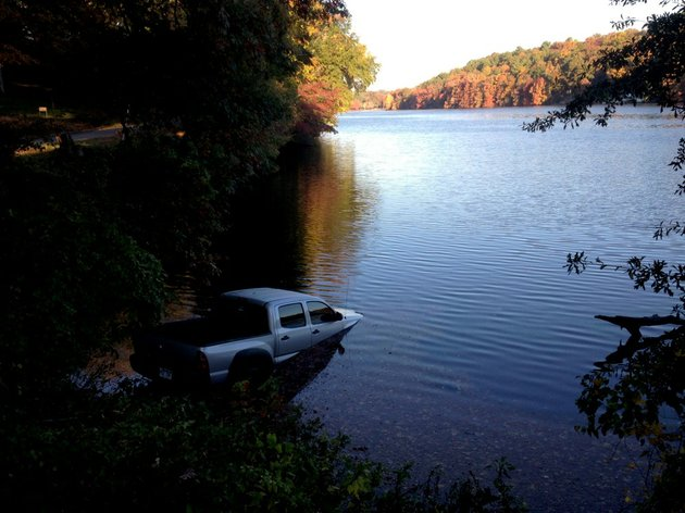 a-pickup-rests-in-north-little-rocks-lake-no-1-on-thursday-nov-7-2013-after-the-driver-got-out-to-take-a-photograph