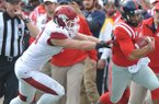 Mississippi quarterback Barry Brunetti (11) is run out-of-bounds by Arkansas' Brooks Ellis (51) during an NCAA college football game at Vaught-Hemingway Stadium Saturday, Nov. 9, 2013, in Oxford, Miss. (AP Photo/Oxford Eagle, Bruce Newman)