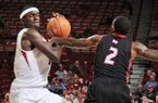 SIU-Edwardsville's Maurice Wiltz, right, attempts to steal the ball from Arkansas's Bobby Portis during the second half of the basketball game on Friday November 8, 2013 in the Bud Walton Arena in Fayetteville.