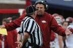 Arkansas' Head Coach Bret Bielema argues with Casey Moreland, umpire Saturday, Nov. 9, 2013, during the second quarter of the game against Ole Miss at Vaught-Hemingway Stadium in Oxford, Miss.