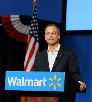 Actor Gary Sinise speaks at Wal-Mart Inc.'s Bentonville headquarters Monday during Veterans Day celebrations. Sinise's nonprofit, the Gary Sinise Foundation, and musical group, the Lt. Dan Band, have raised millions for veterans.