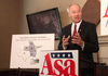 Republican gubernatorial candidate Asa Hutchinson calls for lowering the state's individual income tax for middle-class earners Tuesday at his Little Rock campaign headquarters.