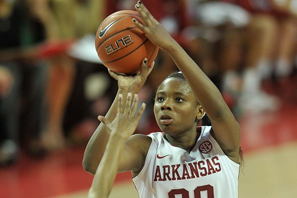 Arkansas' Jessica Jackson pulls up for jump shot over Oral Roberts defender Tysia Manuel in the first half of Wednesday evening's game at Bud Walton Arena in Fayetteville.