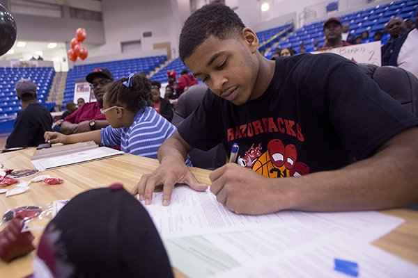 North Little Rock High's basketball player Anton Beard signs with the Arkansas Razorbacks November 14, 2013 at North Little Rock High School.