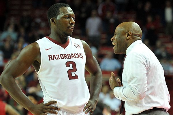 Arkansas coach Mike Anderson talks with Alandise Harris the second half of Friday night's game against Louisiana-Lafayette at Bud Walton Arena in Fayetteville.