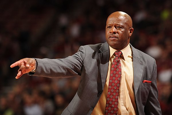Arkansas coach Mike Anderson directs his players from the bench during the second half of play against Southern Methodist Monday, Nov. 18, 2013, in Bud Walton Arena in Fayetteville.