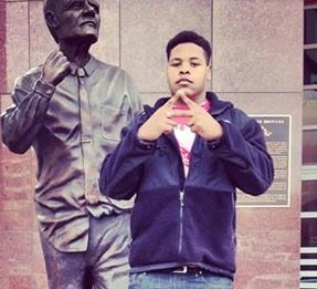Fort Smith Northside junior defensive lineman Daytrieon Dean flashes the A outside the Broyles Complex during a Nov. 20 visit to check out Arkansas' academic opportunities.