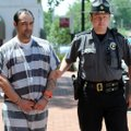 John Proffitt Jr., left, of Rogers, is escorted Wednesday, June 6, 2012, by Sheriff's Deputy Ted Arh...