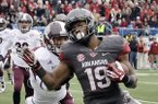 Arkansas wide receiver Javontee Herndon (19) carries to the end zone ahead of Mississippi State defensive back Justin Cox in the first quarter of an NCAA college football game in Little Rock, Ark., Saturday, Nov. 23, 2013. (AP Photo/Danny Johnston)