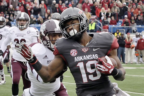 arkansas-wide-receiver-javontee-herndon-19-carries-to-the-end-zone-ahead-of-mississippi-state-defensive-back-justin-cox-in-the-first-quarter-of-an-ncaa-college-football-game-in-little-rock-ark-saturday-nov-23-2013-ap-photodanny-johnston