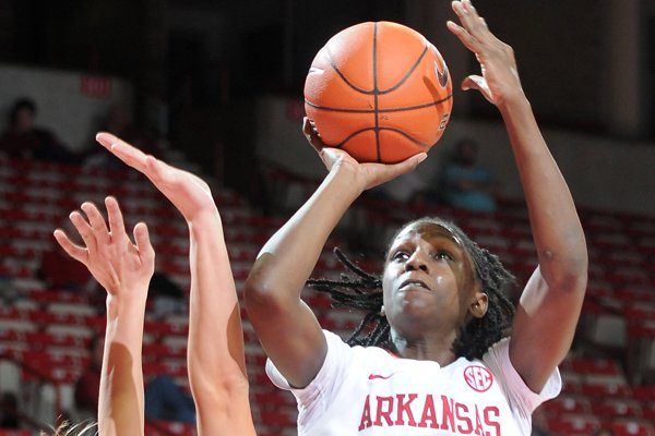 Arkansas guard Keira Peak, goes up for a shot Sunday, Nov. 24, 2013, during the second half of the game against Western Michigan at Bud Walton Arena in Fayetteville. Arkansas beat Western Michigan, 61-46.