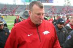 Arkansas coach Bret Bielema and his team leave the field after a 24-17 overtime loss to Mississippi State Saturday at War Memorial Stadium in Little Rock.