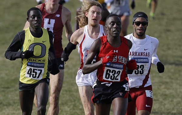 Oregon's Edward Cheserek (457), Texas Tech's Kennedy Kithuka (632), Arkansas' Kemoy Campbell (33) run during the men's NCAA Division I Cross-Country Championships Saturday, Nov. 23, 2013, in Terre Haute, Ind. (AP Photo/Darron Cummings)