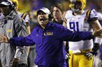 LSU head coach Les Miles reacts to a touchdown call for Texas A&M that was later overturned on replay in the second half of an NCAA college football game in Baton Rouge, La., Saturday, Nov. 23, 2013. LSU won 34-10. (AP Photo/Gerald Herbert)