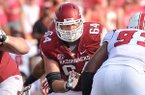 Arkansas center Travis Swanson blocks during an Aug. 31, 2013 game against Louisiana-Lafayette at Razorback Stadium in Fayetteville. Swanson is expected to make his 50th consecutive start Friday at LSU.