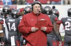 Arkansas coach Bret Bielema walks onto the field in the first half of an NCAA college football game against Mississippi State in Little Rock, Ark., Saturday, Nov. 23, 2013. (AP Photo/Danny Johnston)