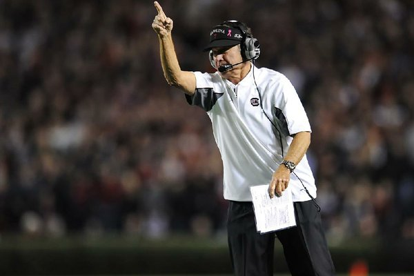 South Carolina head coach Steve Spurrier gestures to his team during the second half of an NCAA college football game against Florida Saturday, Nov. 16, 2013, at Williams-Brice Stadium in Columbia, S.C. South Carolina won 19-14. (AP Photo/ Richard Shiro)
