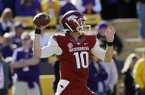 Arkansas quarterback Brandon Allen (10) warms up for an NCAA college football game against LSU in Baton Rouge, La., Friday, Nov. 29, 2013. (AP Photo/Bill Haber)
