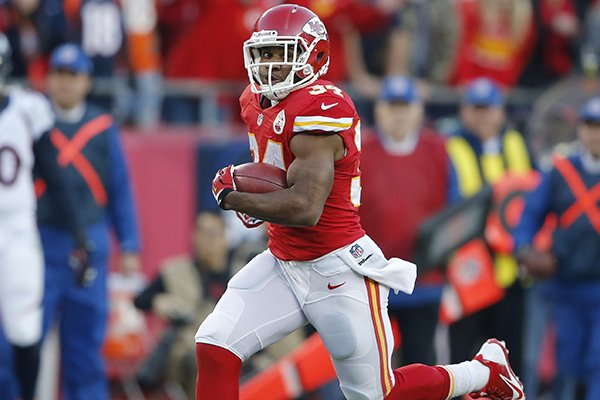 Kansas City Chiefs running back Knile Davis (34) runs on a kick off return for a touchdown during the first half of an NFL football game, Sunday, Dec. 1, 2013, in Kansas City, Mo. (AP Photo/Orlin Wagner)