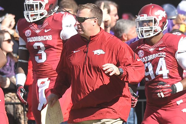 arkansas-coach-bret-bielema-before-the-start-of-a-game-at-tiger-stadium-in-baton-rouge-la-on-nov-29-2013