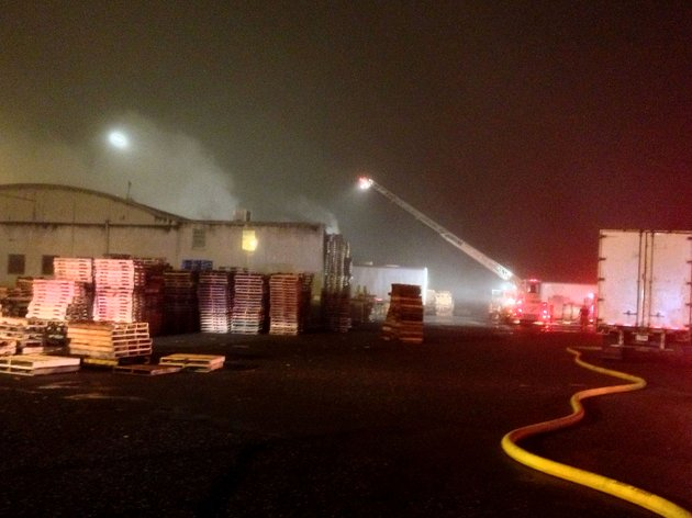 fire-crews-battle-a-blaze-at-the-best-pallet-inc-warehouse-1500-e-15th-street-on-tuesday-night