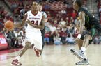 Arkansas' Michael Qualls (24) drives the ball by Southeastern Louisiana's Jeremy Campbell (22) during the first half of an NCAA college basketball game in Fayetteville, Ark., Tuesday, Dec. 3, 2013. (AP Photo/Sarah Bentham)