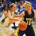 John Brown guard Eliana Fernandez tries to get past Ecclesia defender Tonya Villines as she brings t...
