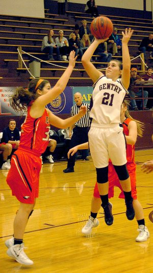 Photo by Randy Moll  Karoline Page, Gentry senior and guard for the Lady Pioneers, makes a jump shot during play against Rogers Heritage on Tuesday, Nov. 21, in Gentry.