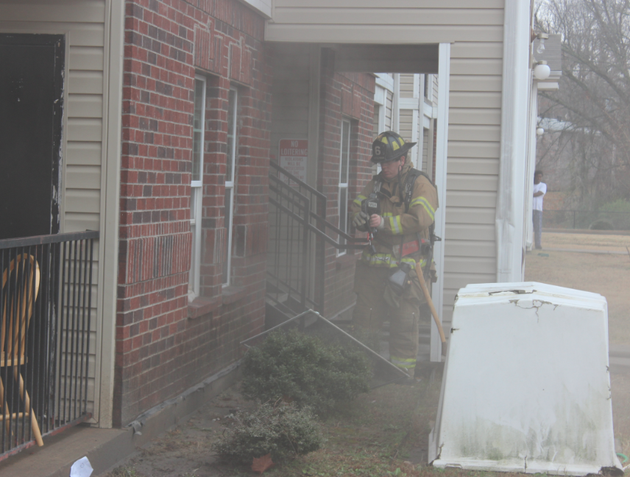 a-firefighter-works-amid-light-smoke-at-the-scene-of-a-fire-at-the-stonewood-apartments-3600-springer-blvd-in-little-rock-on-wednesday-dec-4-2013