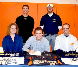 Photo by Dodie Evans  Aaron Means, fielder and pitcher with the Gravette Lion baseball team, signs with Ecclesia College in Springdale.