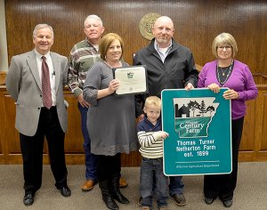 Submitted Photo  Whitny Haley, her husband Pat and son Garrett, along with her parents, Leon and Beverly Whiteside, are pictured with Butch Calhoun, secretary of the Arkansas Agriculture Department, after receiving a Century Farms certifi cate and sign on Nov. 19.