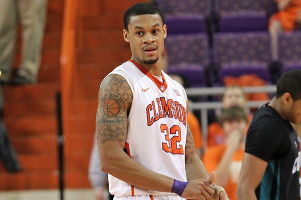 Clemson's K.J. McDaniels. center, reacts after he was charged with a technical foul for hanging on the rim after making a dunk in the second half of an NCAA college basketball game against Coastal Carolina at Littlejohn Coliseum on Friday, Nov. 29, 2013 in Clemson, S.C. (AP Photo/Anderson Independent-Mail, Mark Crammer)
