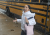 Ashley Munoz, 10, catches snowflakes on her tongue Feb. 20 as she walks from a school bus to the Arts Center of the Ozarks in Springdale earlier this year. Several schools throughout the state have canceled classes Thursday and Friday because of inclement weather.