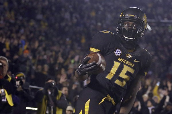 Missouri wide receiver Dorial Green-Beckham, front, celebrates after catching a a 38-yard touchdown pass during the second quarter of an NCAA college football game on Saturday, Nov. 30, 2013, in Columbia, Mo. (AP Photo/Jeff Roberson)