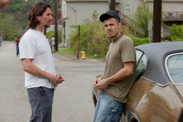 casey-affleck-right-plays-rodney-baze-in-out-of-the-furnace-a-modern-noir-from-the-director-of-crazy-heart