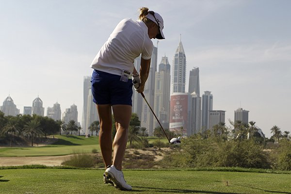 Stacy Lewis of the U.S. tees off on the 8th hole during the 3rd round of the Dubai Ladies Masters golf tournament in Dubai, United Arab Emirates, Friday, Dec. 6, 2013. (AP Photo/Kamran Jebreili)