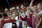 Arkansas fans congratulate players following an NCAA college basketball game in Fayetteville, Ark., Monday, Nov. 18, 2013. Arkansas beat SMU 89-78. (AP Photo/Sarah Bentham)