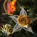 "Ornaments called Chrismons, a contraction of ""Christ monogram,"" decorate a tree in the sanctuary of ..."