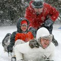Darin Phelan gives his wife Jessica and son Lucas,6, a push Friday as they begin there tandem slide ...