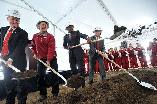 University of Arkansas chancellor G. David Gearhart, women's head basketball coach Tom Collen, men's head basketball coach Mike Anderson, and athletic director Jeff Long throw dirt during the official groundbreaking for the new Razorback Basketball Performance Center Saturday afternoon in Fayetteville.