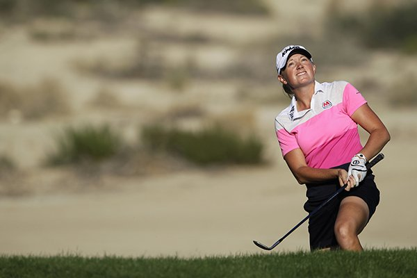 Stacy Lewis from the U.S. follows up her ball on the 15th hole during the final round of the Dubai Ladies Masters golf tournament in Dubai, United Arab Emirates, Saturday, Dec. 7, 2013. (AP Photo/Kamran Jebreili)