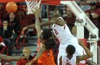 Arkansas forward Alandise Harris blocks the shot of Clemson guard Rod Hall in the first half of Saturday afternoon's game against the Tigers at Bud Walton Arena in Fayetteville.