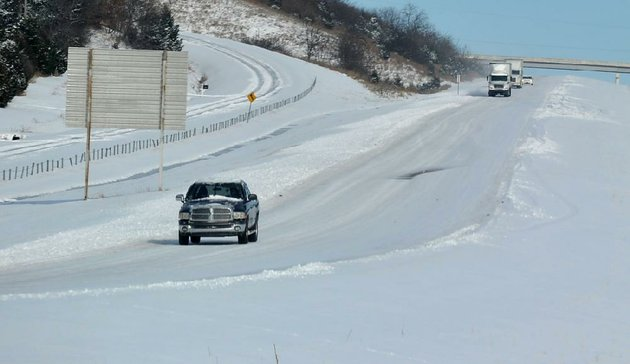 traffic-moves-slowly-across-the-ice-covered-south-bound-lanes-of-interstate-540-south-of-greenland-after-a-december-winter-storm