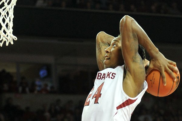 Arkansas forward Michael Qualls goes up for a dunk. Qualls is the Razorbacks' leading scorer, averaging 15.8 points per game.