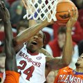 Arkansas guard Michael Qualls drives to the basket against Clemson defenders Sidy Djitte and K.J. Mc...