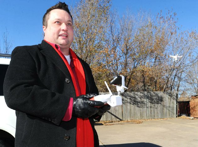 nwa-mediaandy-shupe-tim-stein-executive-broker-with-bassett-mix-associates-inc-pilots-a-remote-controlled-drone-that-he-uses-to-record-video-and-still-photographs-of-properties-wednesday-nov-27-2013-at-the-real-estate-companys-office-in-fayetteville