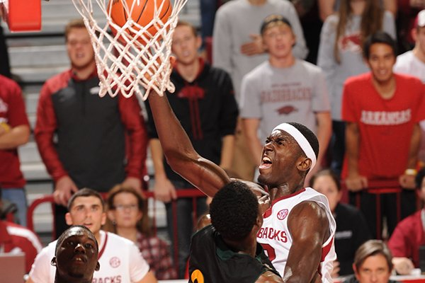 Arkansas forward Bobby Portis, right, scores as Southeastern Louisiana guard Jeffery Ricard (24) defends during the second half of play Tuesday, Dec. 3, 2013, in Bud Walton Arena in Fayetteville.