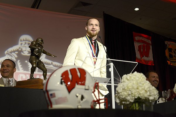 Jared Abbrederis, senior wide receiver for the University of Wisconsin, accepts the Burlsworth Trophy Monday, Dec. 9, 2013 during the trophy ceremony at the Northwest Convention Center in Springdale. The award, presented by the Springdale Rotary Club, is given an outstanding college football player who started as a walk-on.