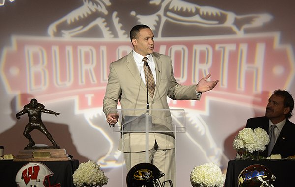 Robert Smith, ESPN football analyst, speaks Monday, Dec. 9, 2013 during the fourth annual Brandon Burlsworth Trophy at the Northwest Convention Center in Springdale.