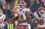 Kansas City Chiefs running back Knile Davis carries the ball into the end zone for a touchdown during the second half of an NFL football game in Landover, Md., Sunday, Dec. 8, 2013. (AP Photo/Pablo Martinez Monsivais)